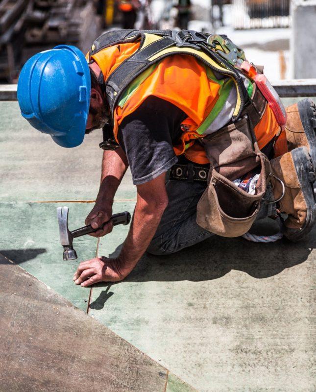 Builder working following building notice